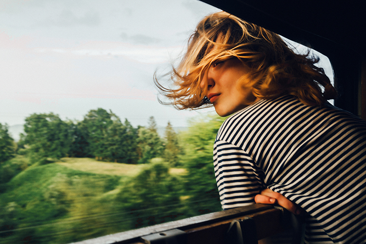 Woman looking at the view from train
