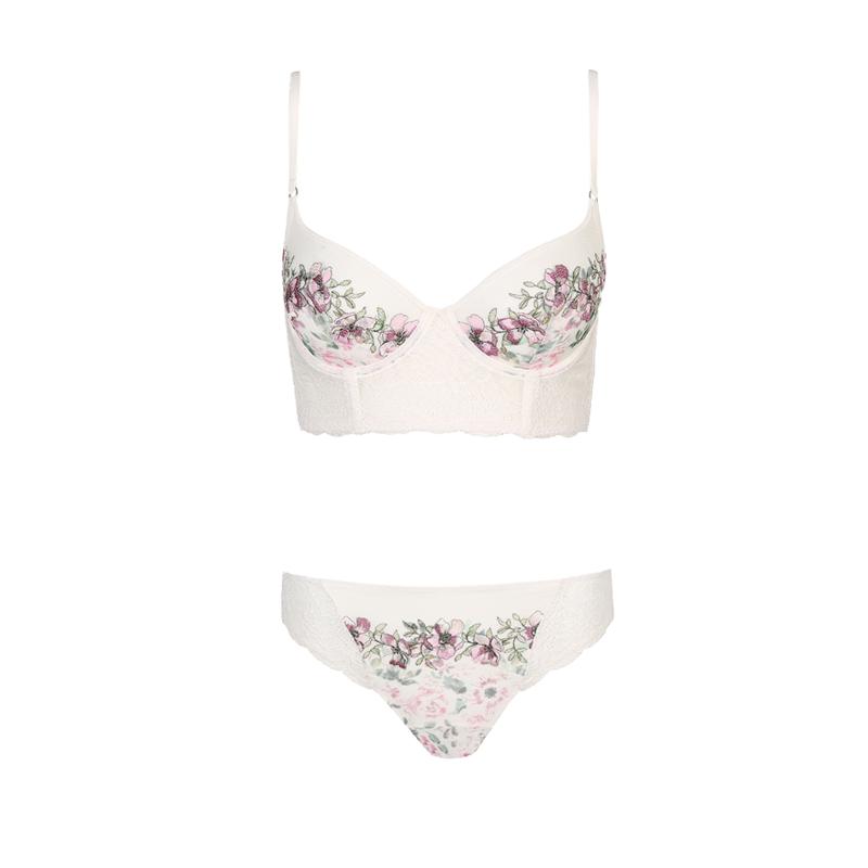 produktabbildung von weißem dessousset mit floralem print bestehend aus bustier und slip von der marke MarieJo L'Aventure