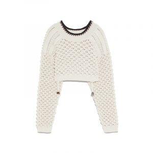 produktbild weißer pullover mit löchern