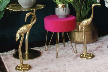dekoration mit goldenen kranichen