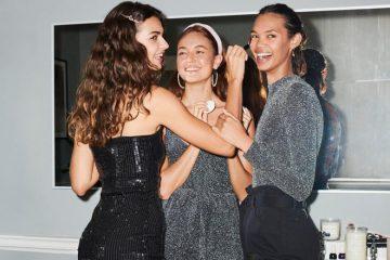 Lachende Frauen in Glitzerkleidern